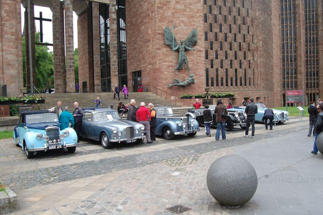 Alvis cars in front of Coventry Cathedral