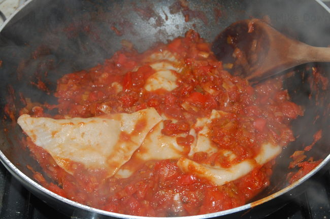 Kreplach in red pepper sauce